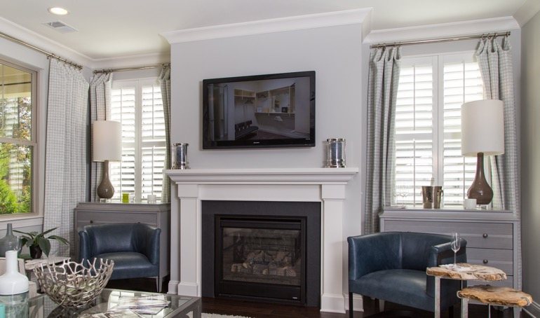 Plantation shutters near fireplace