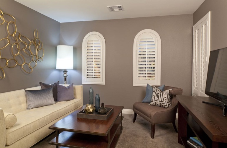 Kingsport family room with arced plantation shutters.