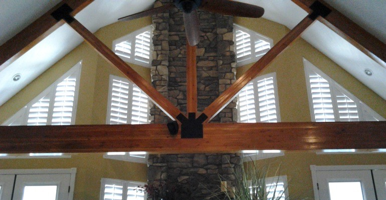 rake windows with custom shutters in Kingsport house