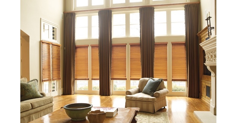 Kingsport great room with natural wood blinds and floor to ceiling draperies.