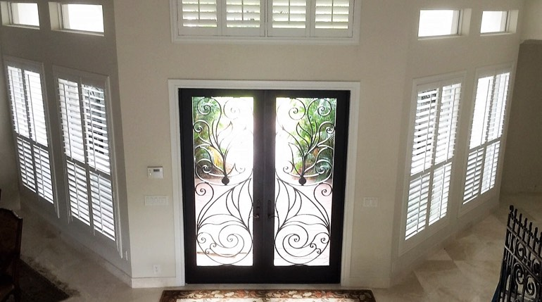 Kingsport foyer with glass doors and plantation shutters