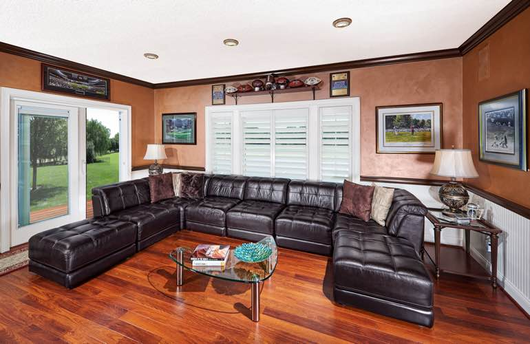 Kingsport basement with sliding doors and plantation shutters.