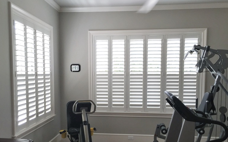 Kingsport home gym with shuttered windows.