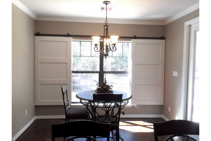 Kingsport dining room with sliding barn door shutters.