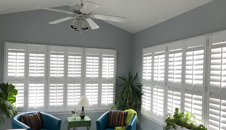 Kingsport sunroom with fan and shutters