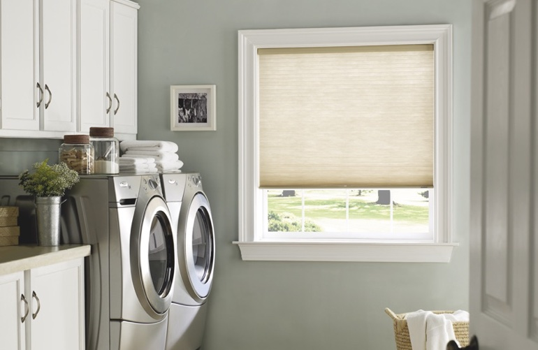 Kingsport laundry room with beige window shades.