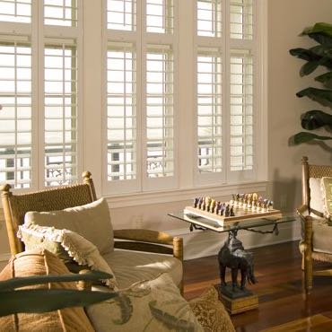 Kingsport living room polywood shutters.