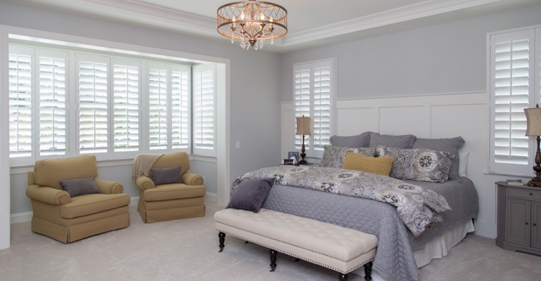 Plantation shutters in Kingsport bedroom.