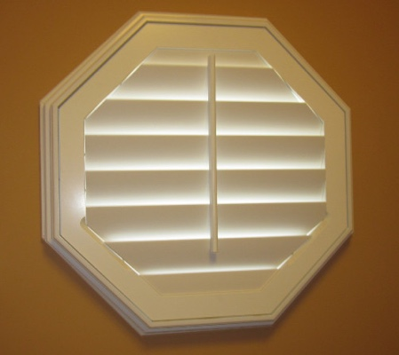 Kingsport octagon window with white shutter