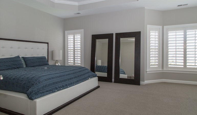 Polywood shutters in a minimalist bedroom in Kingsport.