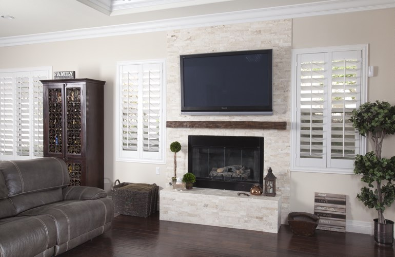 White plantation shutters in a Kingsport living room with solid hardwood floors.
