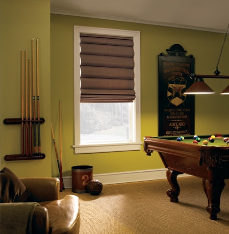 Roman shades in Kingsport pool room with green walls.