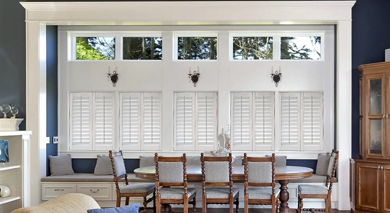 Shut classic plantation shutters in Kingsport dining room.