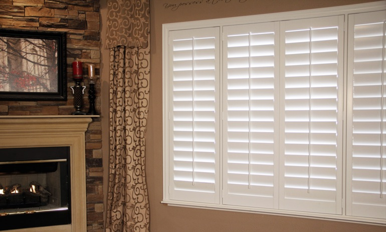 Kingsport Studio plantation shutters in family room.