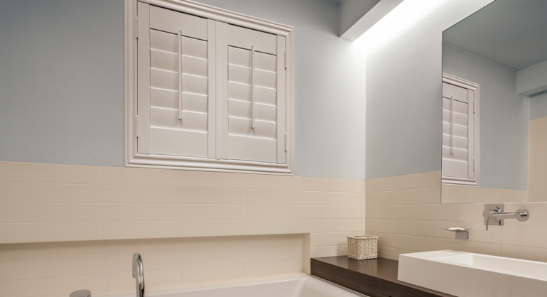 Studio waterproof shutters in Kingsport bathroom.
