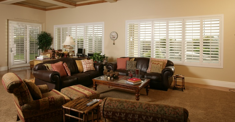 Kingsport sunroom with white shutters.