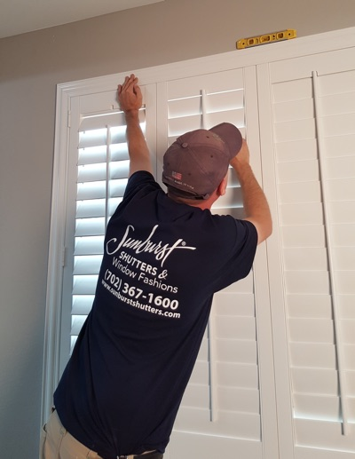 Shutter installation in Kingsport bedroom.