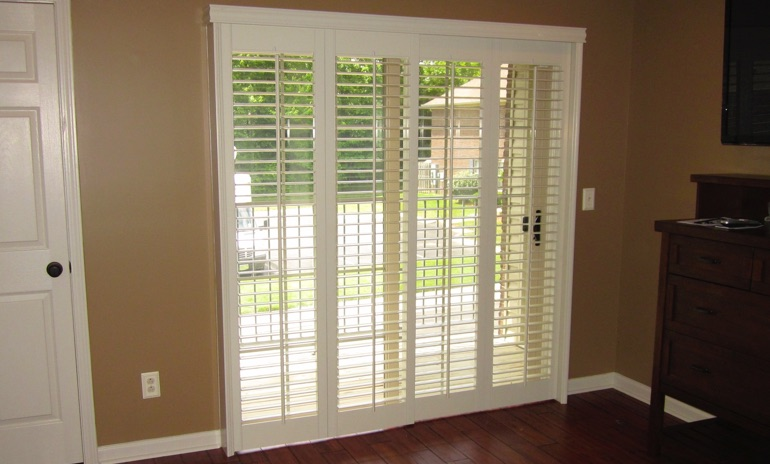 Kingsport sliding door bifold shutters in patio