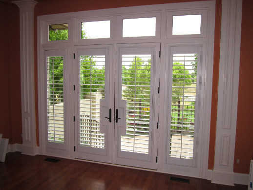 Kingsport patio door with sidelight shutters