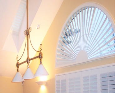 Kingsport arched eyebrow window with classic shutter