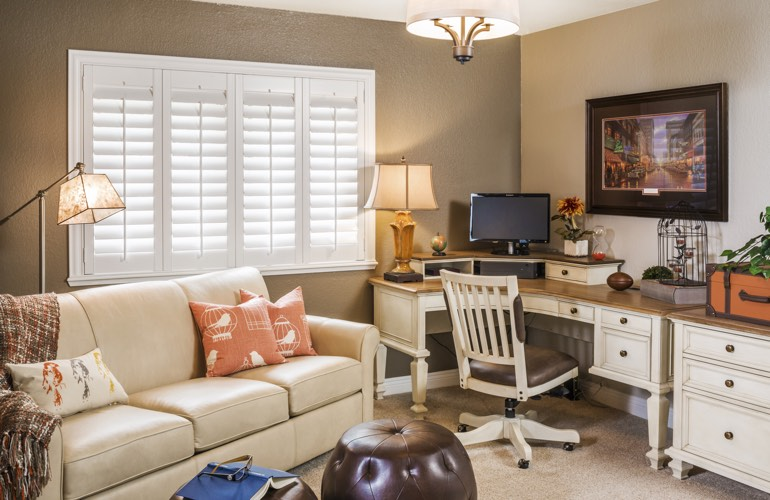 Kingsport home office with plantation window shutters.