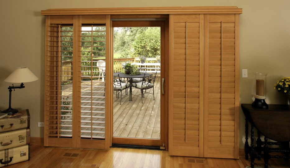 Wood bypass patio door shutters in Kingsport living room