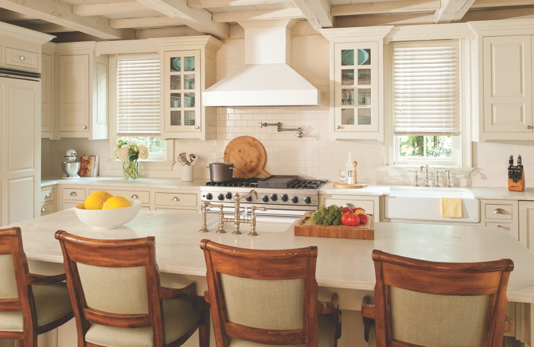 Kitchen windows covered with blinds
