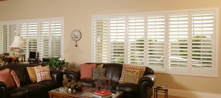 Wide window with interior shutters in Kingsport living room